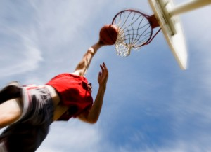 Athlete shooting hoops