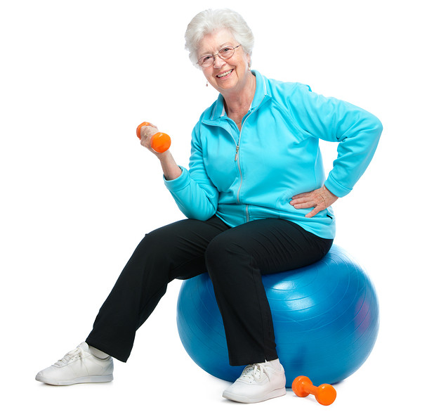 Senior woman working with weights in gym - Central City Physiotherapy